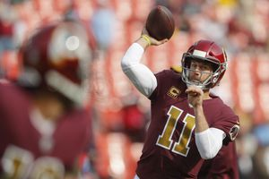 (AP Photo/Pablo Martinez Monsivai, Files) | Washington Redskins quarterback Alex Smith (11) warms up before an NFL football game against the Houston Texans, in a Sunday, Nov. 18, 2018 file photo, Smith, a University of Utah alum and the No. 1 pick in the 2005 NFL Draft, announced his retirement from football on Monday.