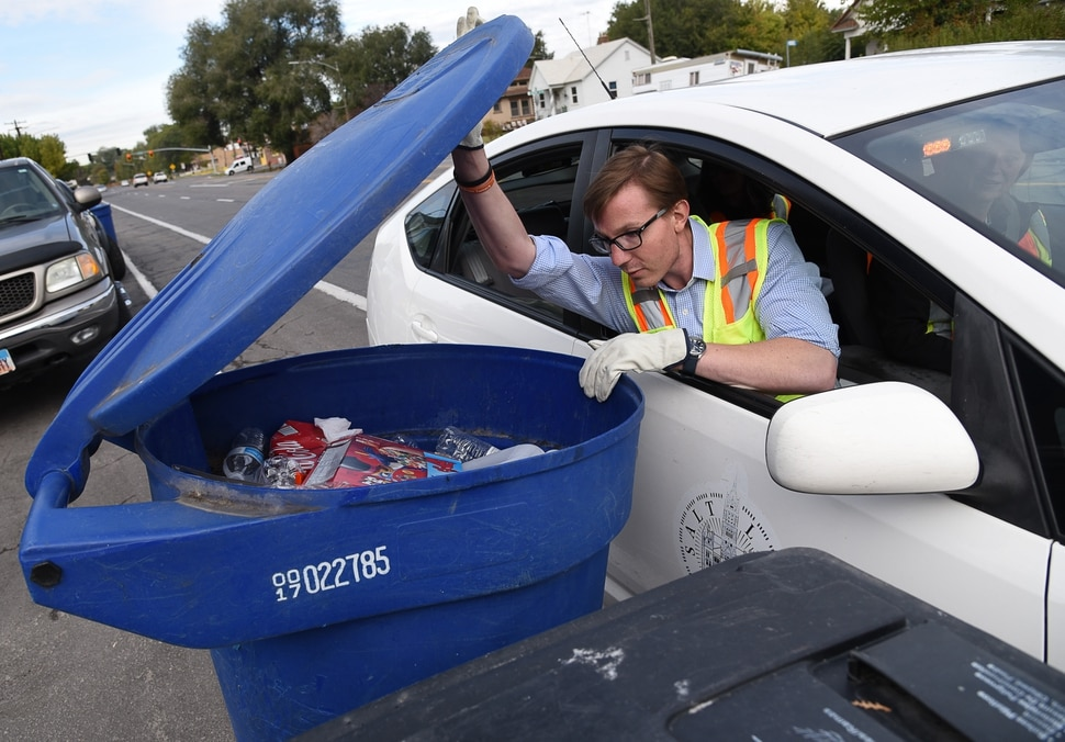 (Francisco Kjolseth | The Salt Lake Tribune) David Johnston, permits coordinator for Salt Lake City Corporation Sanitation Division checks on people's recycling bins in an effort to reduce waste problems in the recycling stream. One of the primary changes in the last year is the recycling program no longer takes styrofoam or plastic bags, including plastic bags that might be used to hold peoples recyclables.