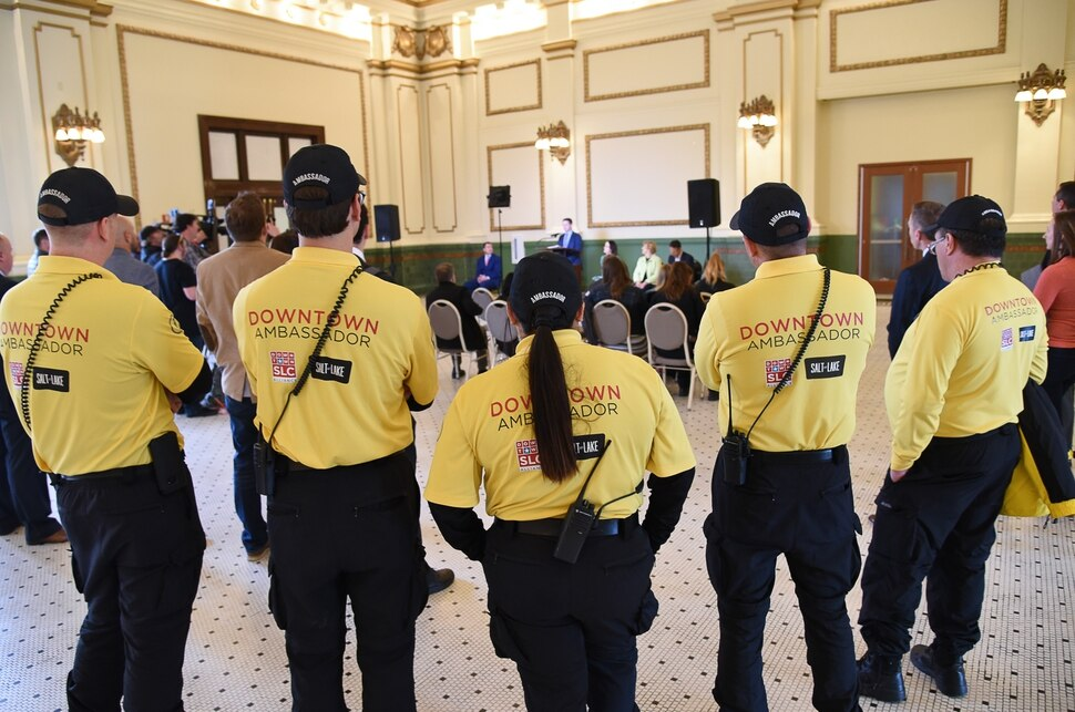 (Francisco Kjolseth | The Salt Lake Tribune) Downtown Embassadors attend an announcement in the Grand Hall at The Gateway on Tuesday, April 2, 2019, as two new reports claim that The Gateway and the Rio Grande area of downtown Salt Lake City has seen a dramatic decrease in crime. Speakers shared details on the efforts and resulting impact the security measures have had on the district.