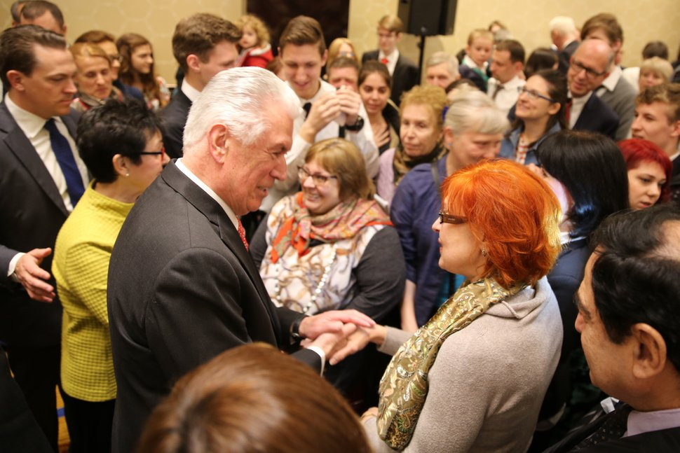 (Courtesy LDS Church) Elder Dieter F. Uchtdorf of the Quorum of the Twelve Apostles and his wife, Harriet, greet Latter-day Saints in Moscow, Russia, April 22, 2018.