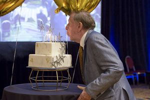 (Rebecca Reed) Historian Richard Bushman blows out the candles on his 90th birthday cake during a celebration at a Salt Lake City hotel Sept. 25, 2021.