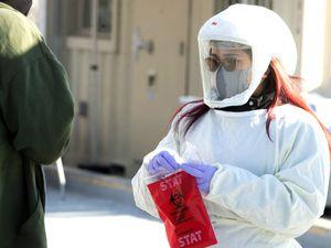 (Rick Egan | The Salt Lake Tribune) Zeanne Timbol administers a test for COVID-19 at the Intermountain Salt Lake Clinic, on Saturday, Jan. 2, 2021.