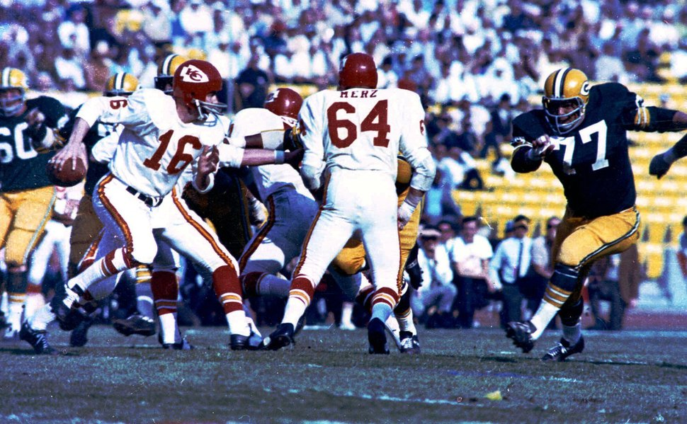 (AP Photo) In this Jan. 15, 1967, file photo, Kansas City Chiefs quarterback Len Dawson (16) looks for an opening against the Green Bay Packers during Super Bowl 1 in Los Angeles. The Packers defeated the Chiefs 35-21.