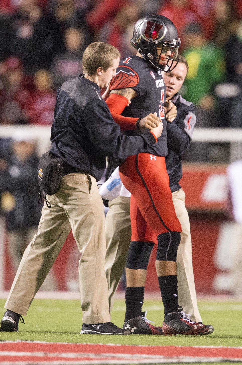 Rick Egan | The Salt Lake Tribune Utah Utes quarterback Kendal Thompson (1) is helped off the field, in PAC-12 action, Utah vs. Oregon game, at Rice-Eccles Stadium, Saturday, November 8, 2014