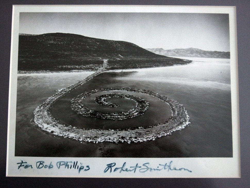 (Steve Griffin | The Salt Lake Tribune) Artist Robert Smithson gave Bob Phillips this signed photograph of the Spiral Jetty. Phillips was the contractor who built the Spiral Jetty for Smithson.