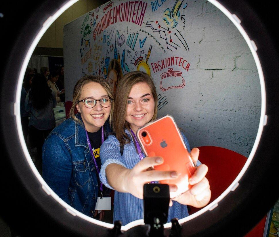 (Rick Egan | The Salt Lake Tribune) Megan Duclof and Erika Rigby take a selfie at the SheTech Explorer Day event, at the Mountain America Expo Center in Sandy, Tuesday, April 9, 2019.