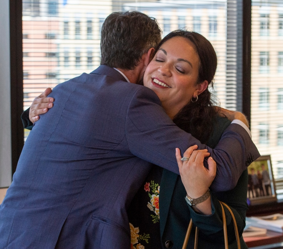(Rick Egan | The Salt Lake Tribune) Derek Miller, the president and CEO of the Salt Lake Chamber and Downtown Alliance hugs Salt Lake City Mayoral candidate, Luz Escamilla after interviewing her for his podcast, Monday, Sept. 30, 2019.