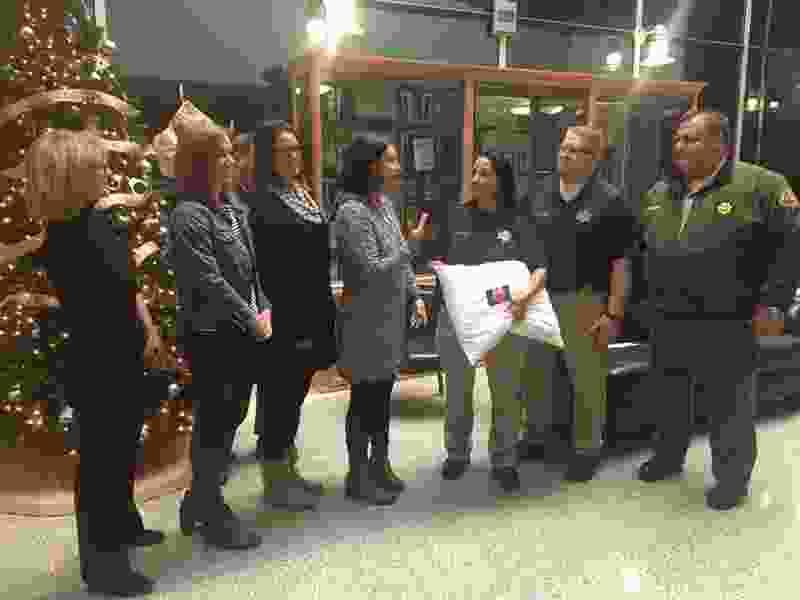 Organization brings holiday comfort to Salt Lake County jail inmates by donating 600 pillows