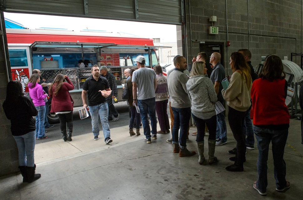(Steve Griffin | The Salt Lake Tribune) Access Development employees line up for a free food truck lunch on the company after attending an open enrollment benefits meeting at the Salt Lake City company Thursday November 16, 2017.