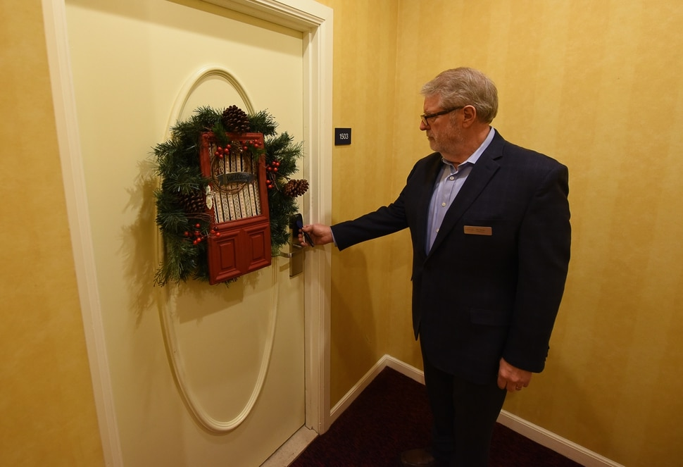 (Francisco Kjolseth | The Salt Lake Tribune) Ric Tanner, general manager at Salt Lake City's Hotel Monaco, gives a tour of the Christmas-themed suite on the 15th floor.