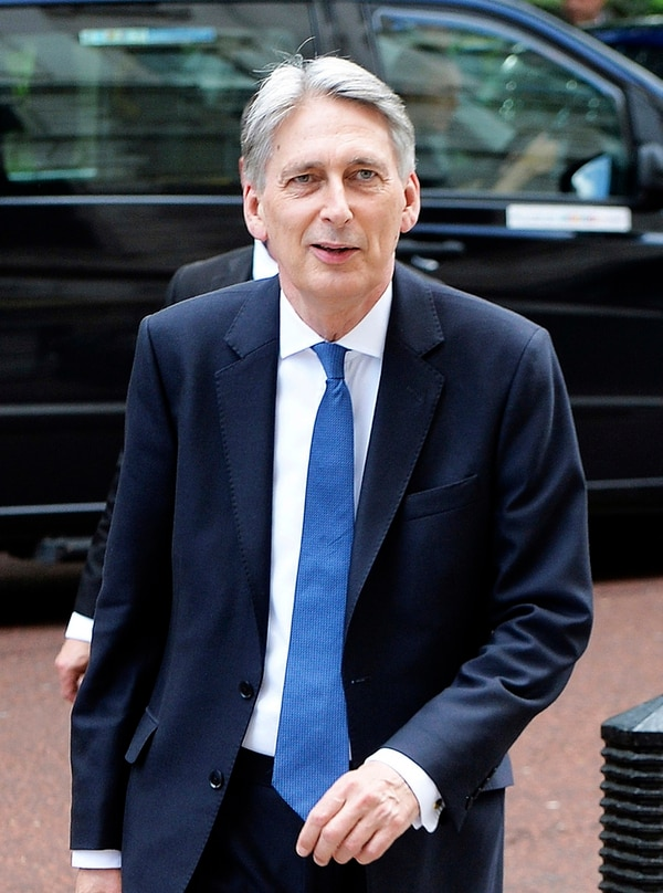 Britain's Chancellor Philip Hammond arrives at the Treasury in Whitehall, London, after Downing Street said that Theresa May is to leave her most senior Cabinet team in place following a disastrous election which left the party short of a majority in parliament, Friday, June 9, 2017. (John Stillwell/PA via AP)