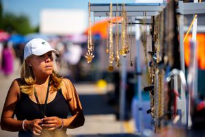 (Trent Nelson  |  The Salt Lake Tribune) Marisol Gonzalez sets out jewelry at the swap meet at the Redwood Drive In Theatreand  Swap Meet in West Valley City on Saturday, June 26, 2021.