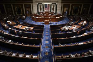 (J. Scott Applewhite | AP photo)  The House Chamber is empty after a hasty evacuation as rioters tried to break into the chamber at the U.S. Capitol on Wednesday, Jan. 6, 2021, in Washington.