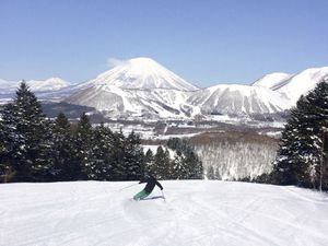 FILE - This March 4, 2016 photo shows a skier at the Rusutsu resort in Hokkaido, Japan. Hokkaido, Japan's northernmost island, is home to a number of ski resorts known for deep snow. Tourism to Japan is booming and Hokkaido has turned up on several lists of top destinations for 2017. (Dan Sherman via AP, File)