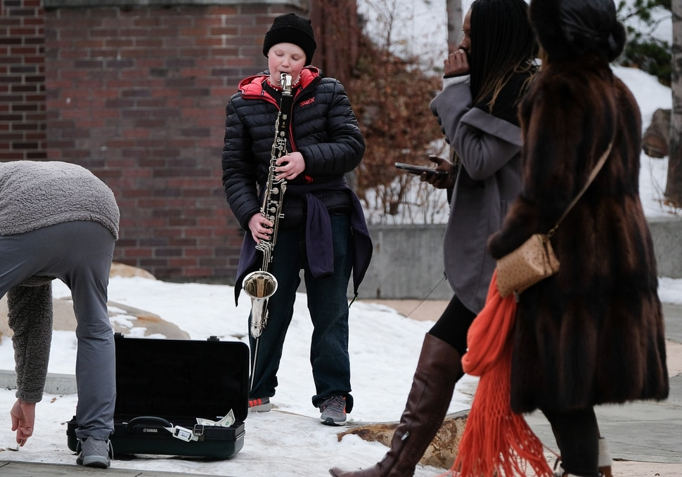 (Francisco Kjolseth | The Salt Lake Tribune) Max McNulty, 12, of Park City, plays music on Main street as the 2018 Sundance Film Festival kicks off its yearly buzz on Thursday, Jan. 18, 2018.
