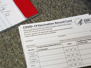 (Jeff Chiu   AP photo)  In this Dec. 24, 2020, photo, a COVID-19 vaccination record card is shown at Seton Medical Center in Daly City, Calif.