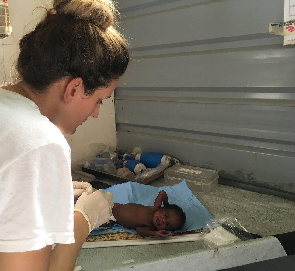 (Photo courtesy Doctors Without Borders) Utah midwife Kirsti Rinne treats an infant at a hosptial near the South Sudan village of Lankien. She just returned from a three-month stint as director of a 24-bed maternity unit near the war zone.