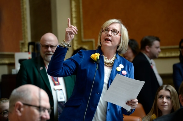 Scott Sommerdorf | The Salt Lake Tribune Rep. Rebecca P. Edwards, R-North Salt Lake, points up to a mural in the House depicting Martha Hughes Cannon voting in 1896, as she speaks about her bill on the House floor, Wednesday, February, 14, 2018. Edwards' bill, SCR001, passed with just three no votes.