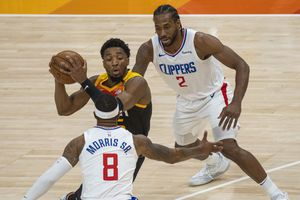 (Rick Egan   The Salt Lake Tribune) Donovan Mitchell (45) splits the LA defenders, forward Kawhi Leonard (2)] and Clippers forward Marcus Morris Sr. (8) to score for the Jazz, in NBA action between the Utah Jazz and the LA Clippers, in game one in the second round of the NBA playoff series at Vivint Arena, on Tuesday, June 8, 2021.