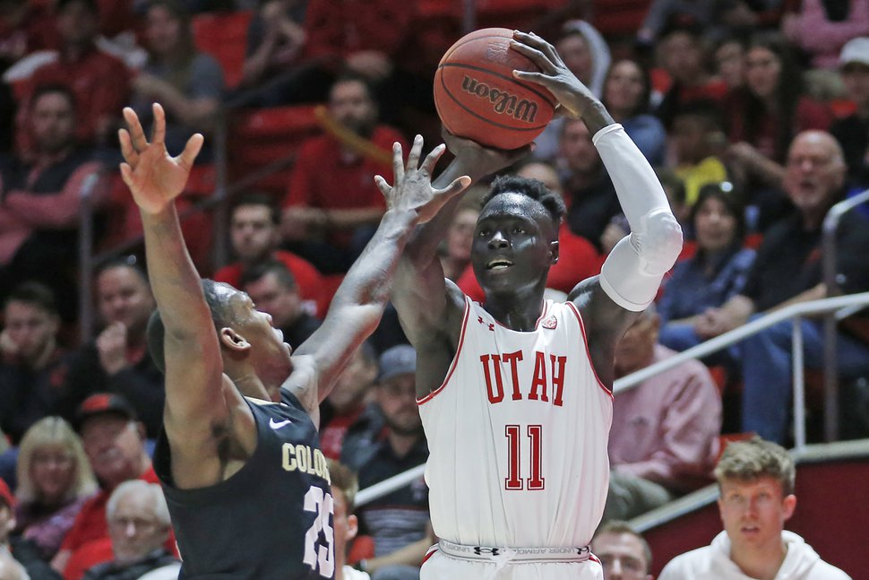 Utah guard Both Gach (11) shoots as Colorado guard McKinley Wright IV (25) defends in the second half during an NCAA college basketball game Saturday, March 7, 2020, in Salt Lake City. (AP Photo/Rick Bowmer)