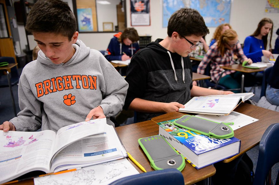 (Trent Nelson | The Salt Lake Tribune) Calvin Bell and Robert Ketchum, students in Monta Thomas' classes at Brighton High School in Cottonwood Heights, work with their cellphones locked away in pouches made by the company Yondr.