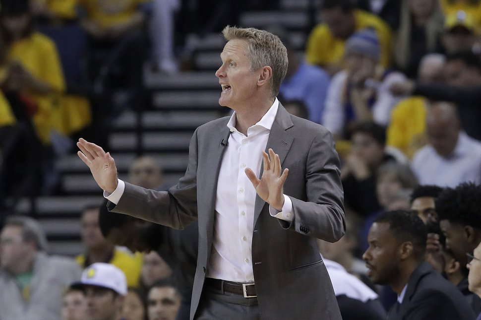 Golden State Warriors coach Steve Kerr gestures during the first half of Game 2 of the team's NBA basketball playoffs Western Conference finals against the Portland Trail Blazers in Oakland, Calif., Thursday, May 16, 2019. (AP Photo/Jeff Chiu)