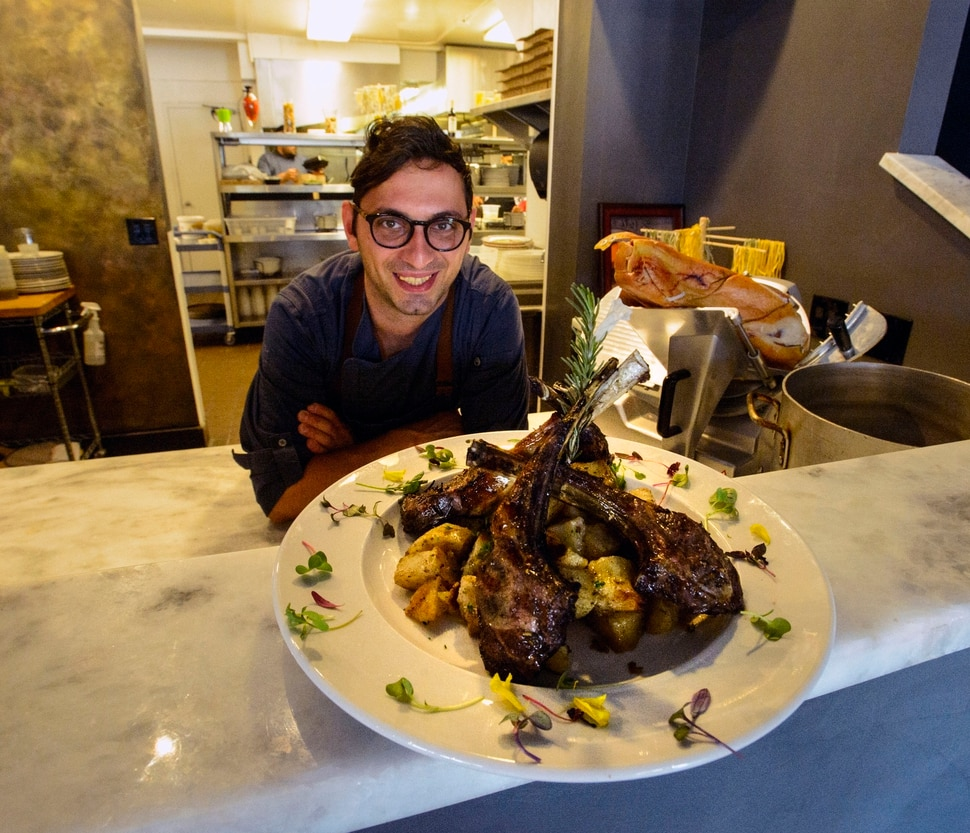 (Steve Griffin | The Salt Lake Tribune) Carmine Delli Bovi, owner and chef at Carmine's Italian Cuisine, with the Agnello e patate al forno (grilled lamb and roasted potatoes), in Cottonwood Heights Thursday October 19, 2017
