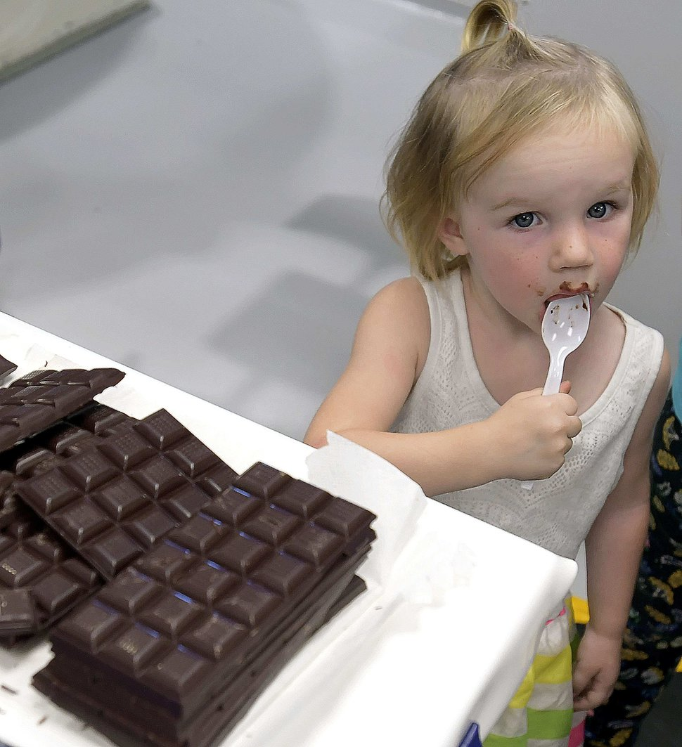 (Eli Lucero | The Herald Journal) Quinn Esplin has a taste of dark chocolate during a public tour of the Aggie Chocolate Factory in Logan on Tuesday, Sept. 4, 2018.