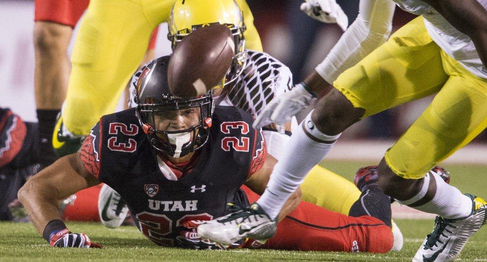 Rick Egan | The Salt Lake Tribune Utah Utes running back Devontae Booker (23) watches the ball bounce away, after fumbling the ball, in PAC-12 action, Utah vs. Oregon game, at Rice-Eccles Stadium, Saturday, November 8, 2014