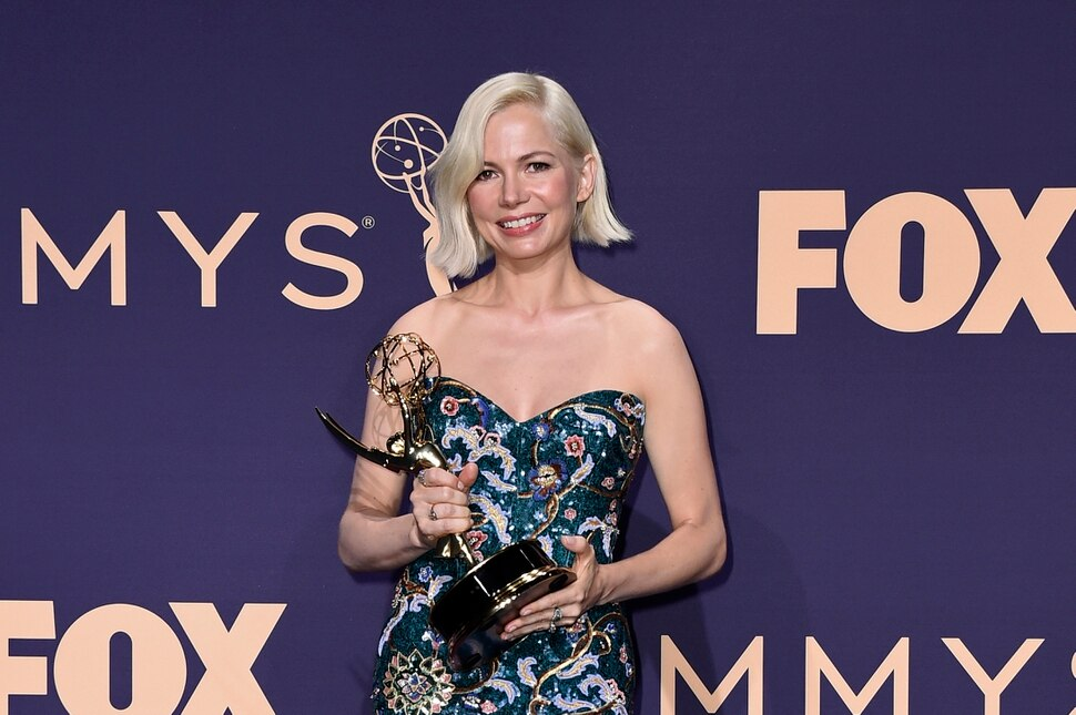 Michelle Williams poses in the press room with the award for outstanding lead actress in a limited series or movie for Fosse/Verdon at the 71st Primetime Emmy Awards on Sunday, Sept. 22, 2019, at the Microsoft Theater in Los Angeles. (Photo by Jordan Strauss/Invision/AP)