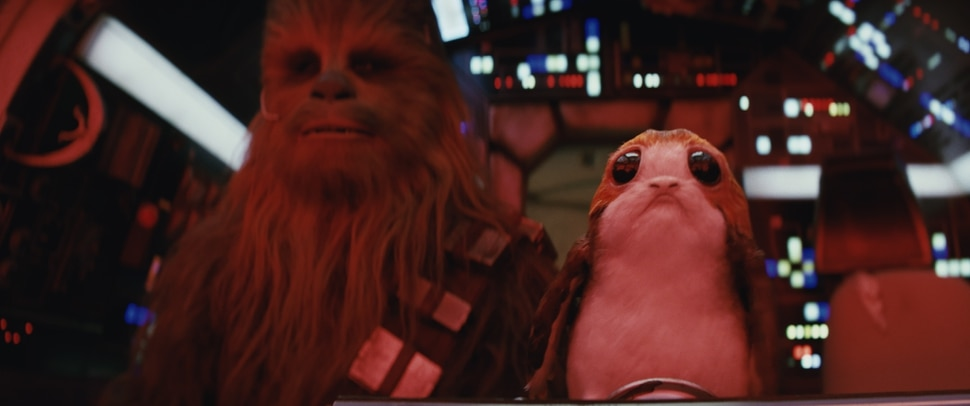 ( | Industrial Light & Magic / Lucasfilm / Disney) A porg rides along in the Millennium Falcon with Chewbacca (Joonas Suotamo) in Star Wars: The Last Jedi.