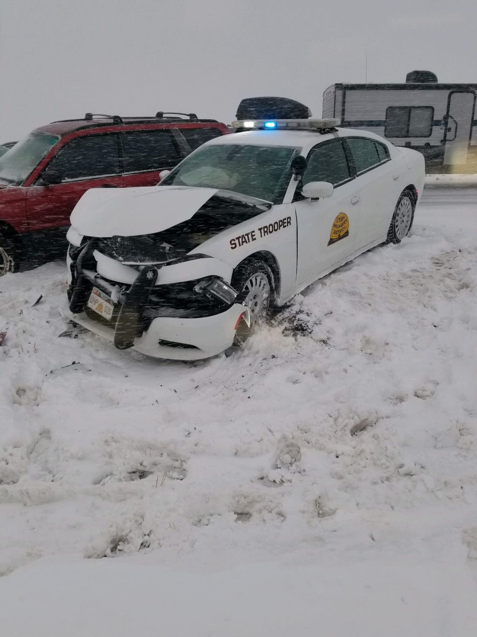 (Photo courtesy of Utah Highway Patrol) A Utah Highway Patrol car was struck head-on Friday. The trooper was trying to slow traffic near Beaver in a snow storm when an SUV collided with the patrol car. The trooper and other driver are OK.