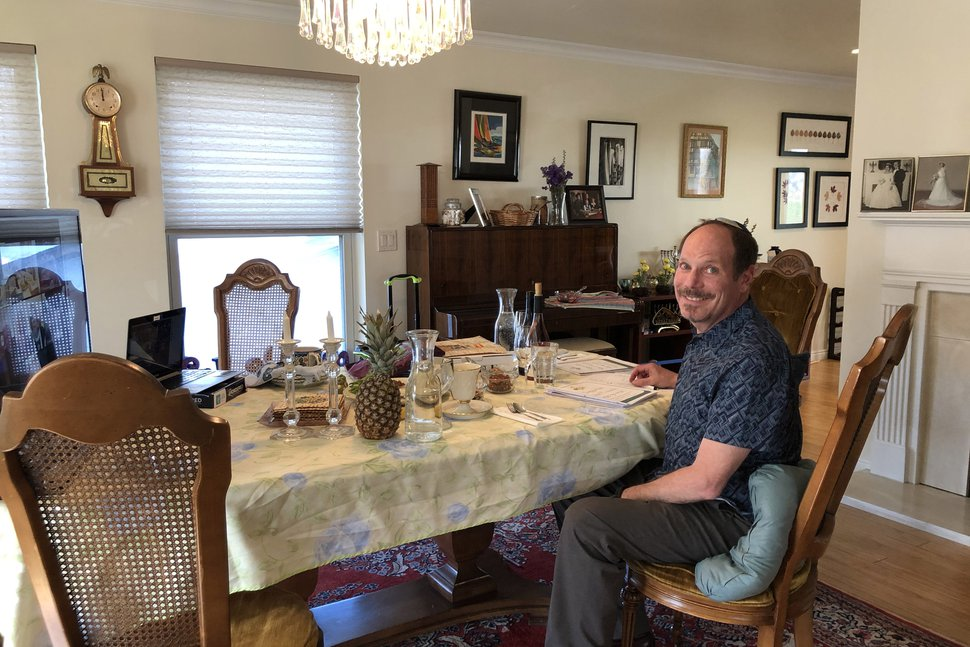 (photo courtesy Diane Hartz Warsoff) Art Warsoff gets ready for a virtual Seder with friends on April 8, 2020.