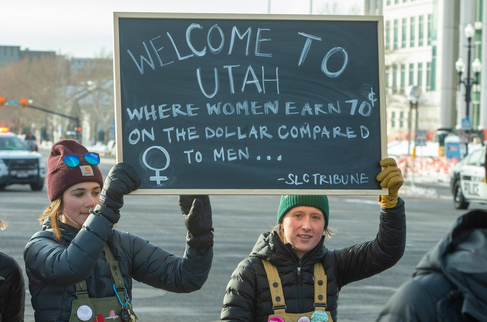 (Rick Egan | The Salt Lake Tribune) Marchers make their way up State Street from Washington Square Park to the Capitol Building, in the 2020 Womxn's March in Salt Lake City, Saturday, Jan. 18, 2020.