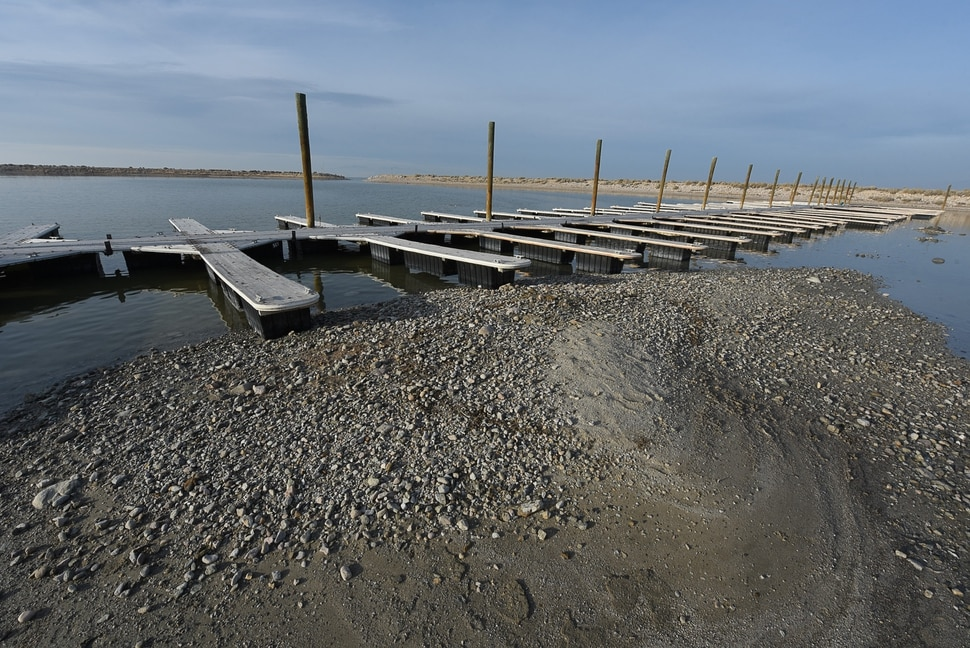 (Francisco Kjolseth | The Salt Lake Tribune) Water levels on the Great Salt Lake have been dramatically receding as seen at the boat marina on Antelope Island and research further confirms that humans are responsible for the decline. Scientists, advocates and water managers weigh in on what needs to be done to reverse the course of history. Saving the lake is possible, they say, but it won't be easy.