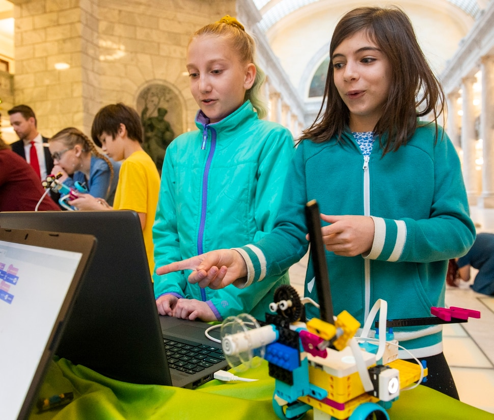 (Rick Egan | The Salt Lake Tribune) Evelyn Goodman and Clara Bigler work on a science project at the State Capitol before Gov. Gary Herbert announced new computer science funding for Utah students at a news conference, Monday, Dec. 9, 2019.