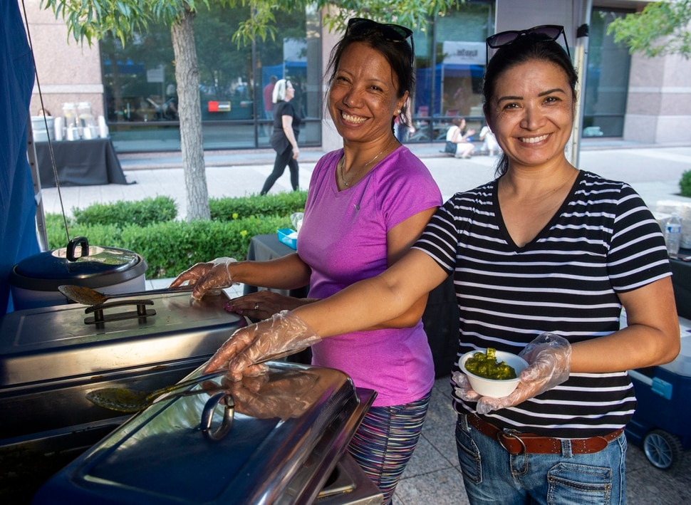 (Rick Egan | The Salt Lake Tribune) Bina and Sita prepare food from Nepal for the Sikkim Momo booth at the Gallivan Center, as Salt Lake City's Spice Kitchen Incubator program serves a variety of international cuisine at the welcome party for the United Nations Civil Society Conference, Sunday, Aug. 25, 2019.