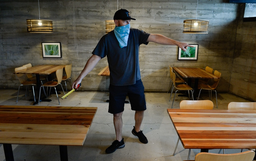(Francisco Kjolseth | The Salt Lake Tribune) Todd Gardiner, co-owner of Taqueria 27, plans out seating arrangements at least 6 feet apart at his Foothill location in Salt Lake City, reducing his seating configuration to half on Thursday, April 23, 2020. Restaurant owners like Gardiner are getting ready to open for sit-down dining on May 1, or whenever state officials say it's OK. After being closed for several weeks, the restaurant opened on Thursday for takeout so it can get the kitchen up and running.