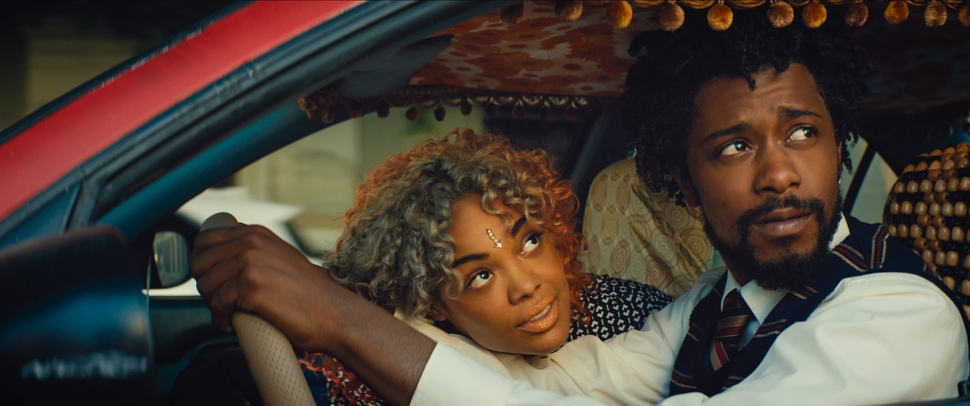 This image released by Annapurna Pictures shows Tessa Thompson, left, and Lakeith Stanfield in a scene from the film, Sorry To Bother You. (Annapurna Pictures via AP)