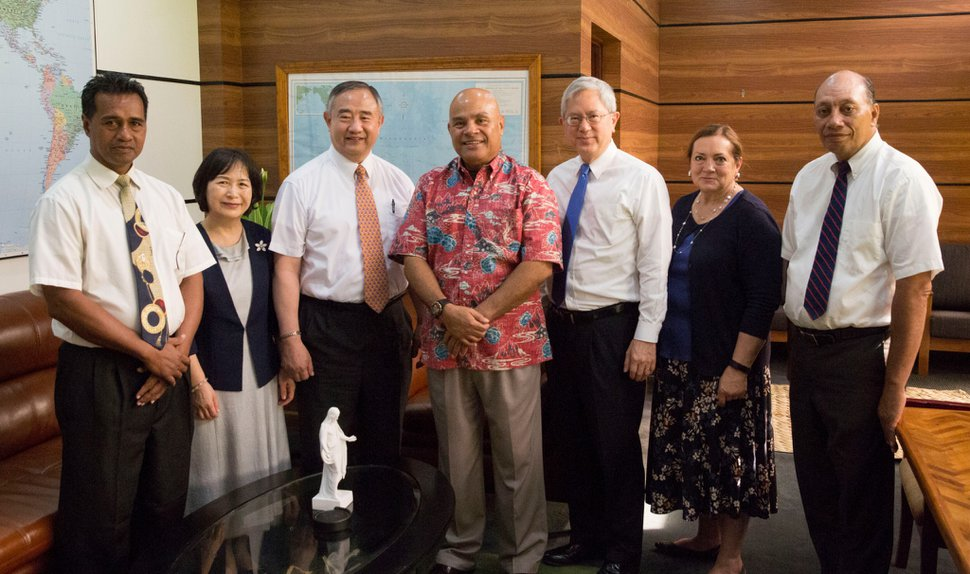 (Photo courtesy of The Church of Jesus Christ of Latter-day Saints) Apostle Gerrit W. Gong, third from right, with his wife, Susan, on his left, and other church leaders during a visit with David W. Panuelo, center, the newly elected president of the Federated States of Micronesia.