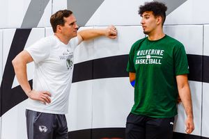 (Leah Hogsten | The Salt Lake Tribune) Utah Valley University basketball coach Mark Madsen talks with team forward Fardaws Aimaq on Monday, July 1, 2019. Madsen chose to trade in life with the L. A. Lakers for life as Utah Valley University's mens' basketball head coach.