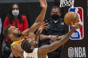 (Rick Egan   The Salt Lake Tribune) LA Clippers forward Kawhi Leonard (2) shoots as Utah Jazz center Rudy Gobert (27) defends, in NBA action between the Utah Jazz and the LA Clippers, in game one in the second round of the NBA playoff series at Vivint Arena, on Tuesday, June 8, 2021.