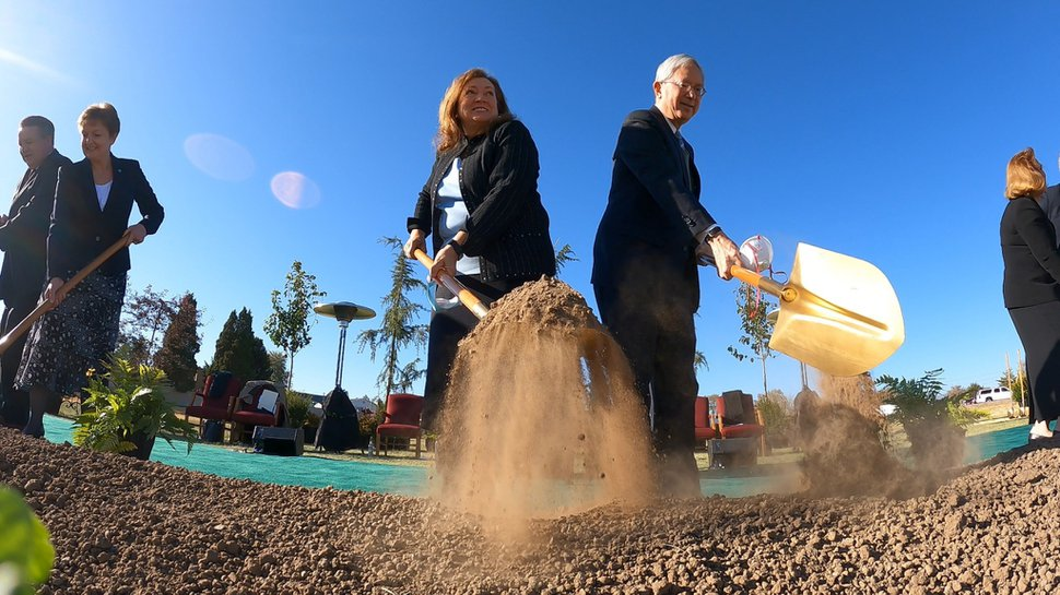 (Photo courtesy of The Church of Jesus Christ of Latter-day Saints) Elder Gerrit W. Gong of the Quorum of the Twelve Apostles and his wife, Susan, participate in the groundbreaking of the Taylorsville Temple on Saturday, Oct. 31, 2020.