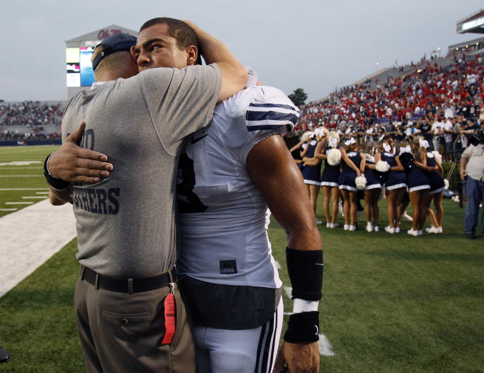 BYU football coach Bronco Mendenhall, left, hugs linebacker Kyle Van Noy following their 14-13 win over Mississippi in their NCAA college football game at Vaught-Hemingway Stadium, Saturday, Sept. 3, 2011, in Oxford, Miss. (AP Photo/Rogelio V. Solis)