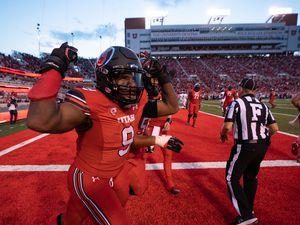 (Francisco Kjolseth | The Salt Lake Tribune) Utah Utes running back Tavion Thomas (9) celebrates a touchdown in PAC-12 football action between the University of Utah and Weber State at Rice-Eccles Stadium on Thursday, Sept. 2, 2021.