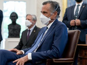 (Andrew Harnik | AP) Sen. Mitt Romney, R-Utah, attends a meeting with President Joe Biden and other members of congress to discuss his jobs plan in the Oval Office of the White House in Washington, Monday, April 19, 2021.