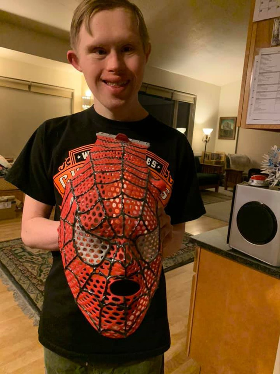(Photo courtesy of Ann Larsen) Isaac Larsen shows off the Spider-Man mesh mask a radiation technician made that he could wear during treatments.