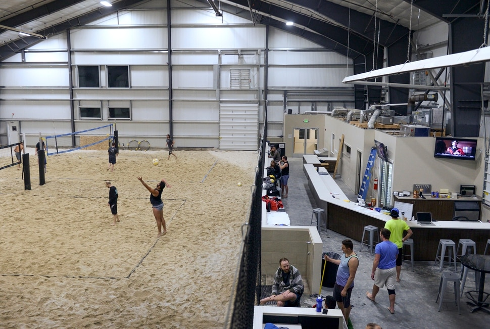 (Leah Hogsten | The Salt Lake Tribune) SandBar's volleyball league members play rounds during the new 8-week spring leagues, Tuesday, March 6, 2018.