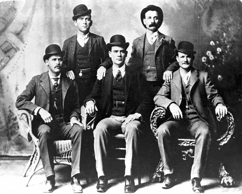 Courtesy Uintah County Regional Center Butch Cassidy and the Wild Bunch. Seated, l-r: Harry Longabaugh (Sundance Kid), Ben Kilpatrick, Butch Cassidy. Standing, l-r, Will Carver, Harvey Logan (Kid Curry).