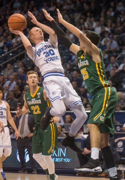 (Rick Egan | The Salt Lake Tribune) Brigham Young Cougars guard TJ Haws (30) shoots over San Francisco Dons center Jimbo Lull (5), in basketball action at the Marriott Center, Saturday, February 10, 2018.